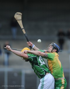 Ross Horan of Scariff in action against Darragh Kelly of O Callaghan's Mills during their game in Cusack Park.