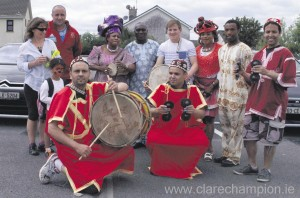 Podge Colliins gets into the spirit of the event with local Moroccan musicians.