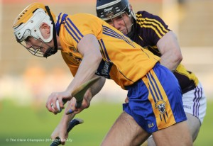 Aaron Cunningham of Clare in action against Andrew Kenny of Wexford during the All-Ireland U-21 final in Semple Stadium, Thurles. Photograph by John Kelly.