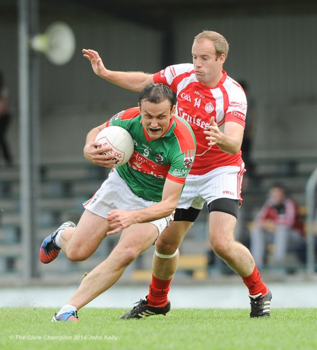 Peter O Dwyer of Kilmurry Ibrickane in action against Stephen Hickey of Eire Og during their senior championship semi-final at Kilmihil. Photograph by John Kelly.