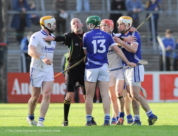 Referee Cathal Mc Allister moves to break up players from Cratloe and Thurles Sarsfield's during their Munster Club quarter final in Cusack park. Photograph by John Kelly.