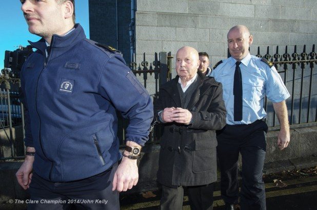 80 year old Kilkee man Patrick Barry is led away after being sentenced at  Ennis Circuit Court on Wednesday. Photograph by John Kelly.