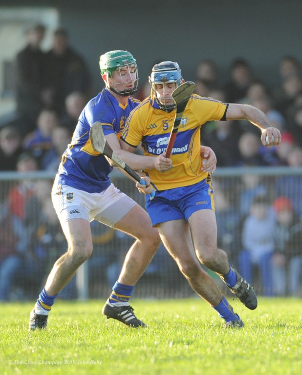 Brendan Bugler of Clare in action against Conor Kenny of Tipperary during their Waterford Crystal Cup game at Sixmilebridge. Photograph by John Kelly.
