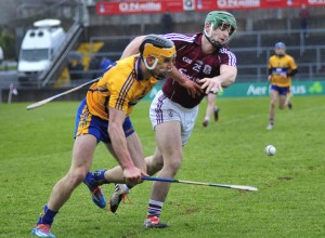 John Conlon of Clare battles for possession with Greg Lally of Galway in last weekend's encounter. Photograph by Declan Monaghan