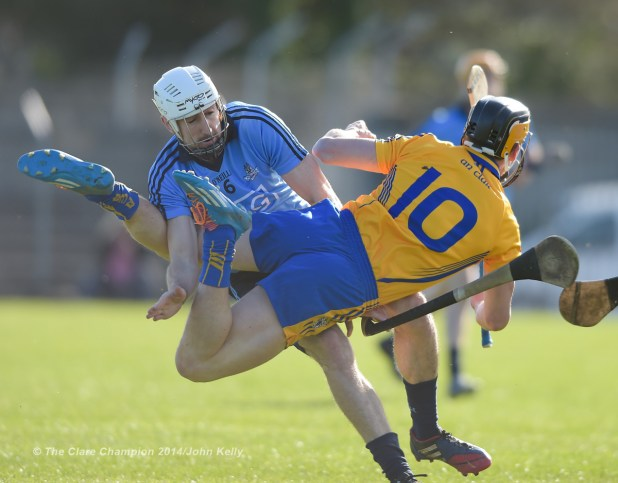 Peter Kelly of Dublin in action against John Conlon of Clare during their NHL Division 1 Round 4 game in Cusack Park. Photograph by John Kelly.