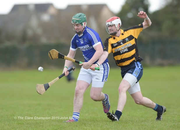 David O' Brien of Cratloe  in action against Sean Mhaoir of Crusheen-Tubber during their U-21 semi final at Clarecastle. Photograph by John Kelly.