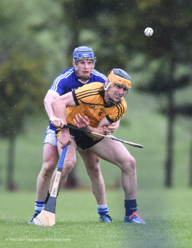 John Conlon of Clonlara in action against Podge Collins of Cratloe during their Clare Champion Cup game at Cratloe. Photograph by John Kelly.