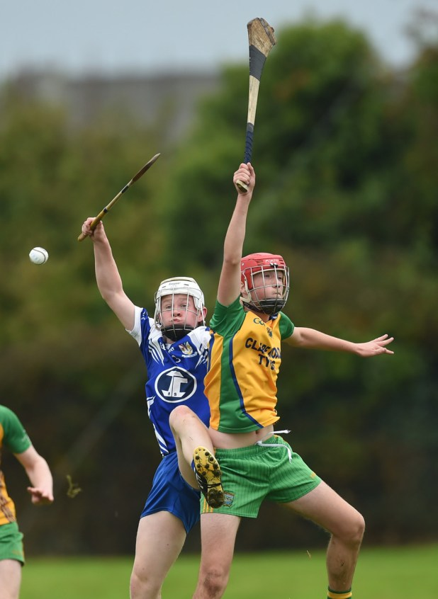 Kilmaley's Darragh Hickey in action against Keith White of Inagh-Kilnamona during their U-16A hurling final.