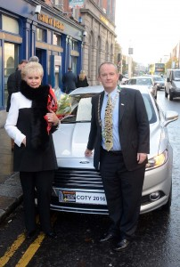 To mark the 50th anniversary of her victory in The Tulip Rally in 1965, Rosemary Smith announced the winning car in the 2016 Continental Irish Car of the Year Awards. She is pictured with the winning car, the Ford Mondeo, along with Irish Motoring Writers' Association Chairman, John Galvin.