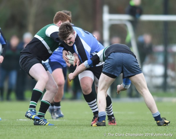 Evan O Gorman of St Caimins in action against Gavin Mc Cormack and Eoin Kelly of Abbey CBS.