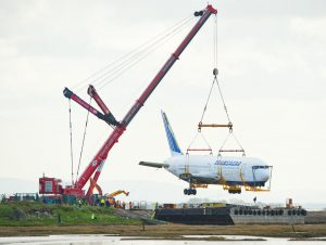 A view of the 767-200 Transaero plane at Shannon being lifted by crane onto a barge. Photograph by John Kelly.