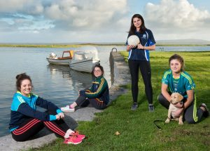 The Harvey sisters; Shauna, Caoimhe, Ciara and Grainne take time out by the Shannon, near their home in Querrin, with pet dog Harley ahead of the big game.Photograph by John Kelly.