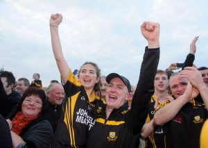 Robbie Hogan, Ballyea manager, and his daughter, Emma watch the cup presentation following the win over Clonlara in the county final replay at Cusack Park. Photograph by John Kelly.
