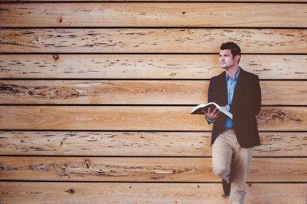 Standing man reading