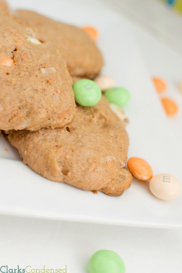 Carrot Cake Cookie Recipe: These cookies are simple, soft, and delicious! Made with a cake mix, these carrot cake cookies just very cake-like because of pineapple, and the added addition of carrot cake M&Ms (or white chocolate chips) help make them melt in your mouth!