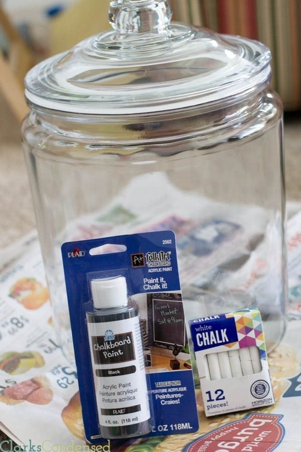 This DIY Chalkboard Glass container is perfect for gifts, storing laundry detergent or baking supplies, and is super easy to make!