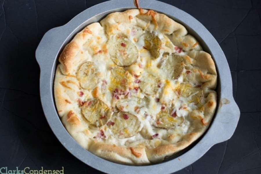 This Bacon and Potato pizza is topped with a creamy ranch sauce, seasoned potato slices, crispy bacon, and a combination of cheddar and mozzarella cheese. Definitely a great choice for any pizza night!