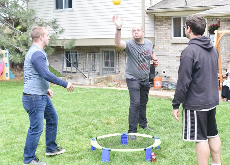 three men playing outdoor games for adults