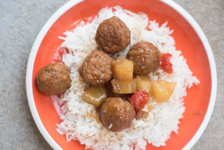 A plate of food, with Meatball