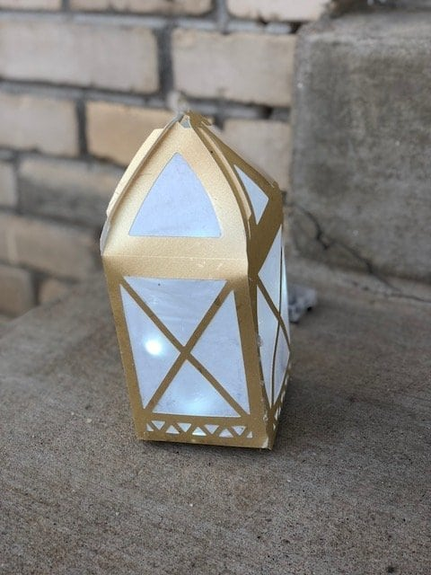 A DIY Paper Lantern in front of a brick building