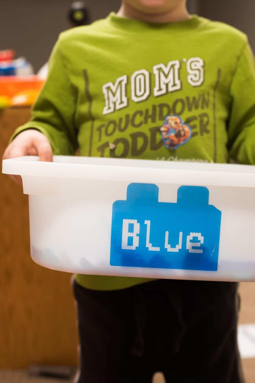 child holding lego box