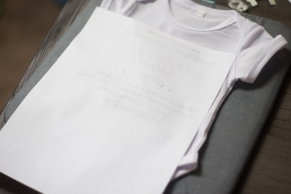 A piece of paper on a baby cloth