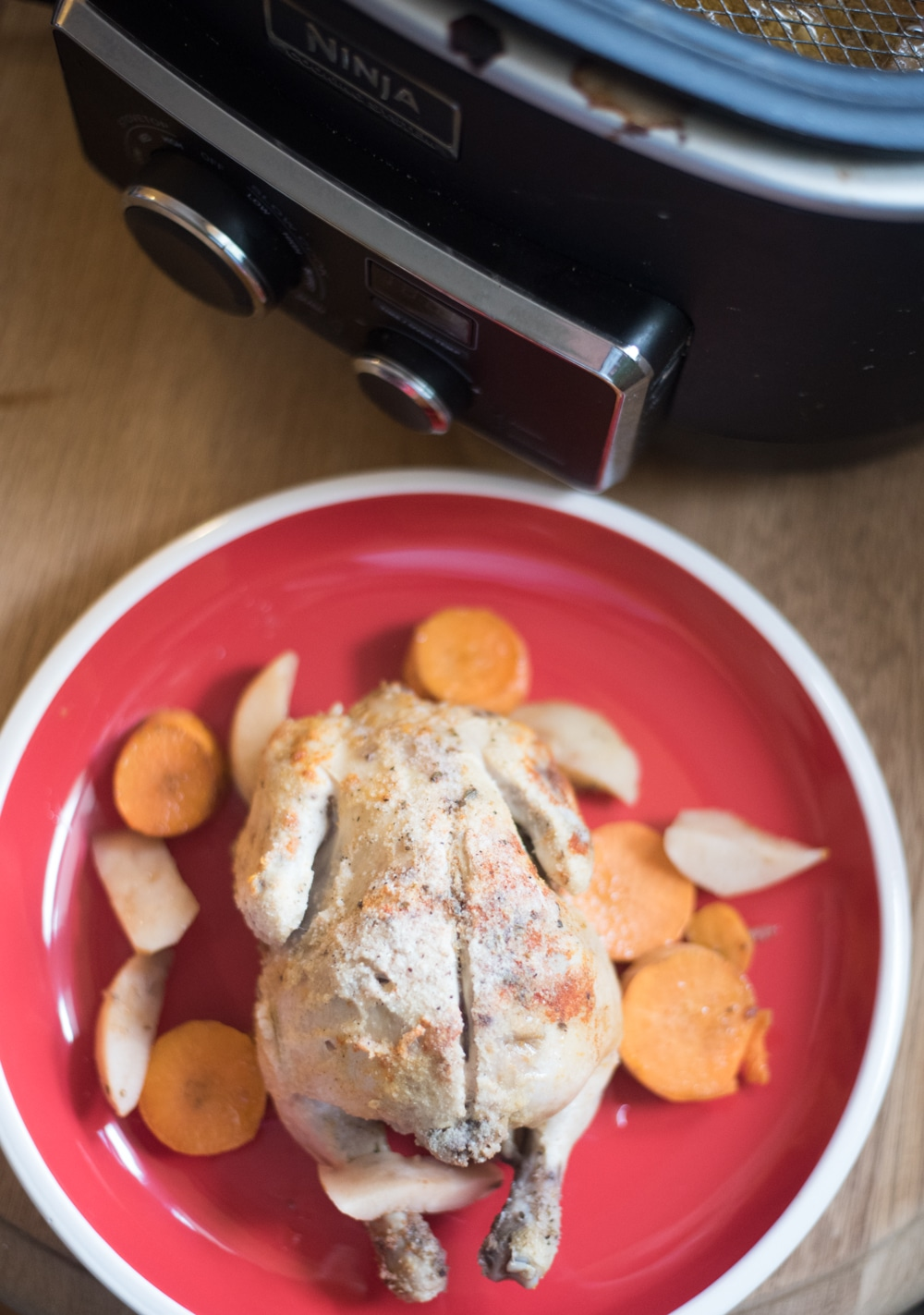 A plate of food on a table, with Slow cooker and Chicken