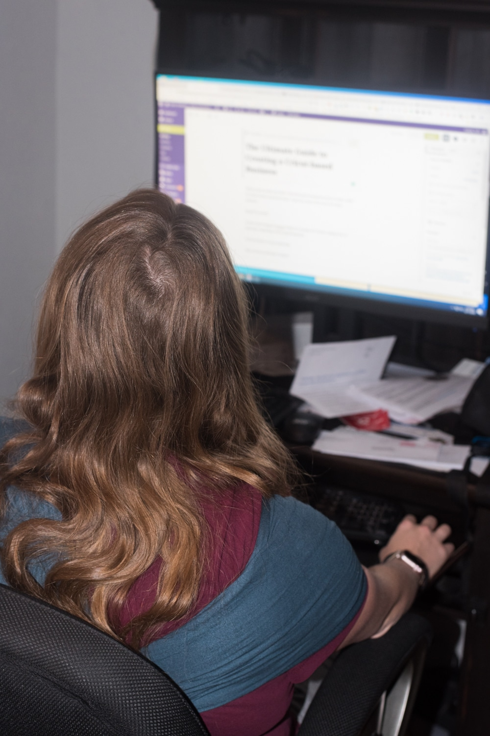 A person sitting at a desk in front of a computer