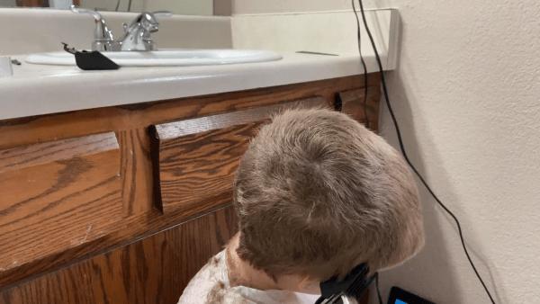 A man sitting in a sink