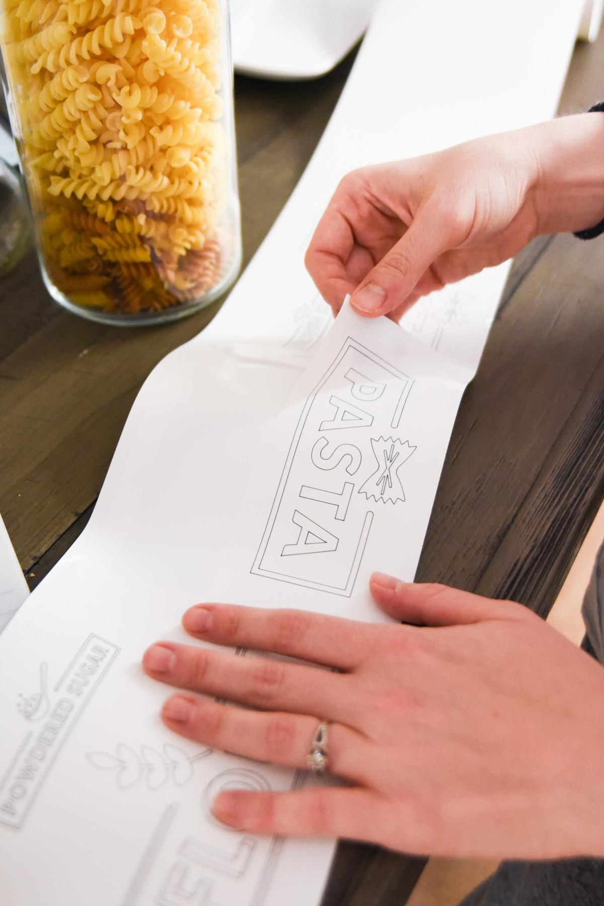 woman peeling label from sheet
