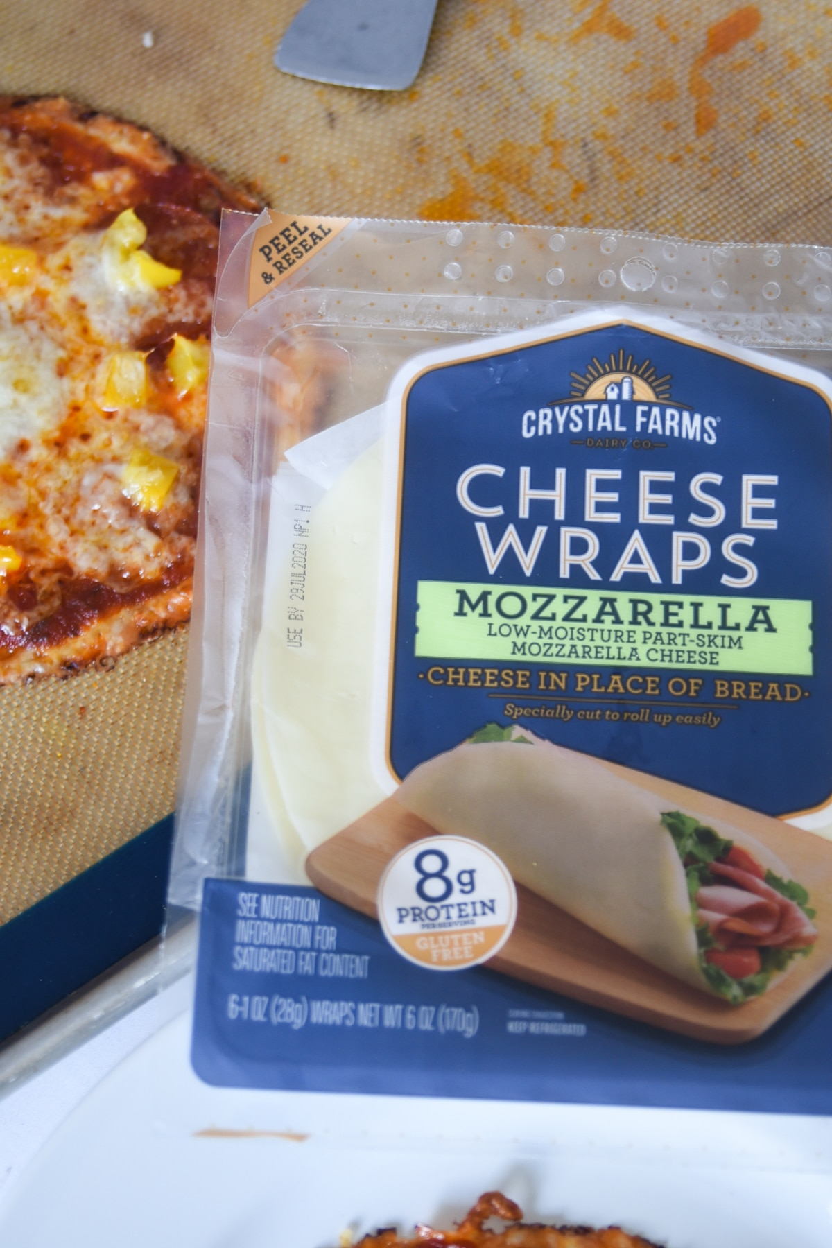 Crystal Farms Cheese Wraps next to a cheese pizza crust