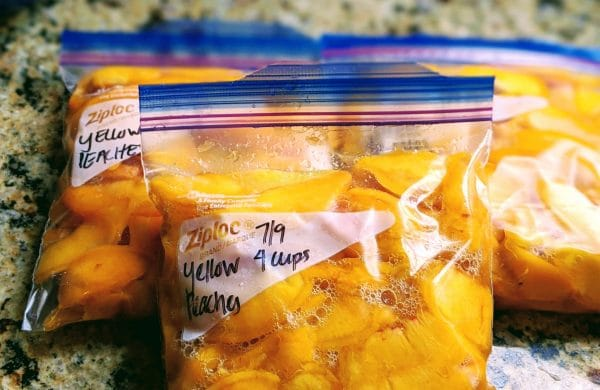 labeled bags with peaches inside