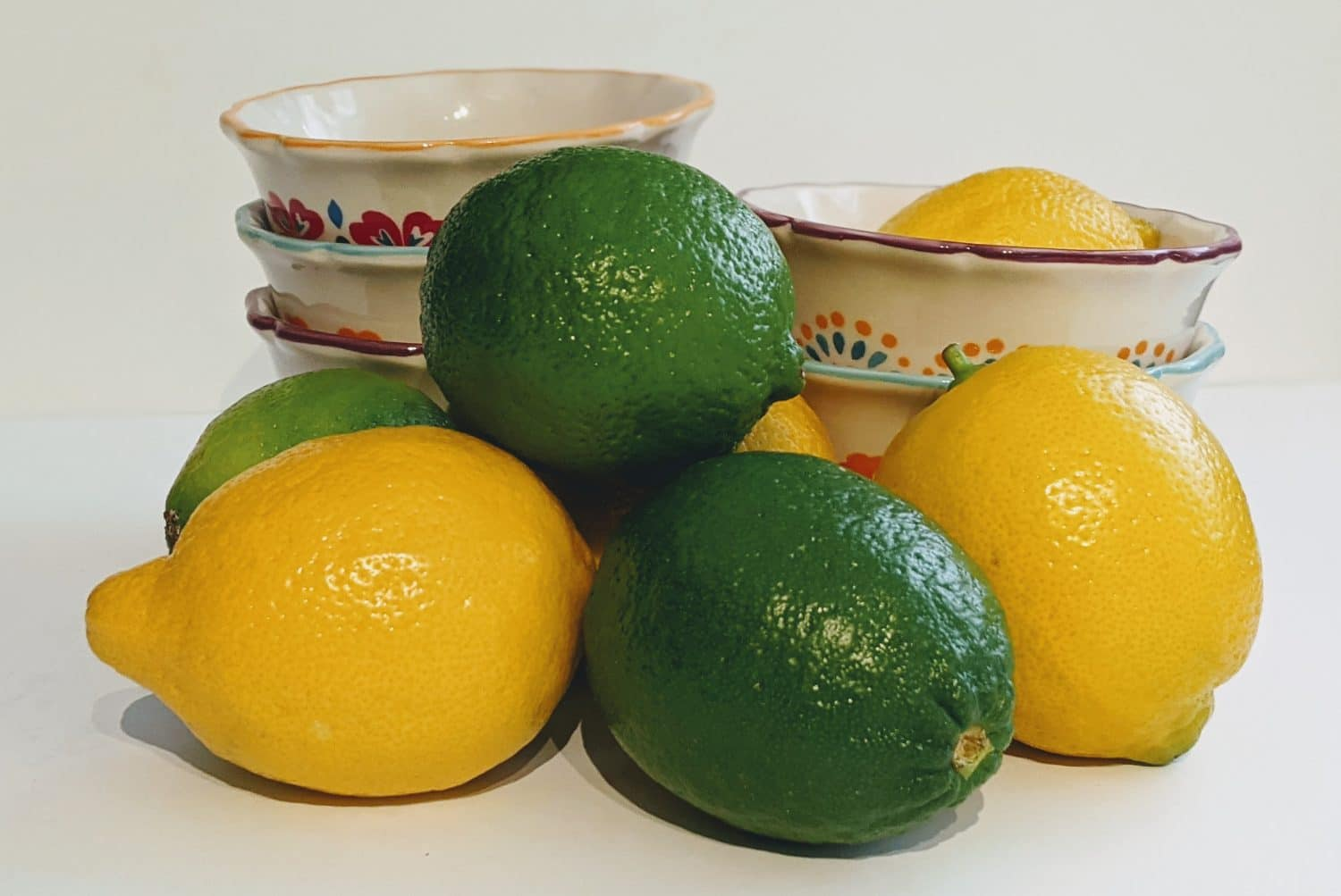 lemons and limes in a dish
