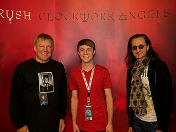 Joseph Kirkwood with Alex Lifeson and Geddy Lee from RUSH