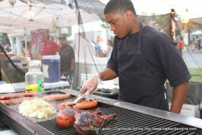 A young man grills up some of the delicious food.