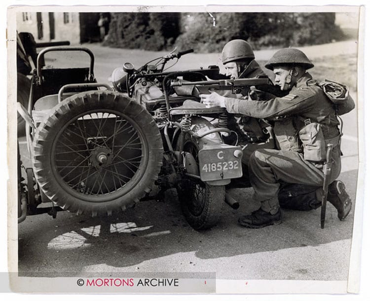 Taking aim, using one of the two-wheel drive Big 4s as cover during World War 2. Photo: Mortons Archive.