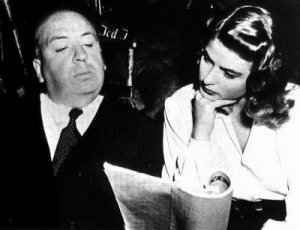 Director Alfred Hitchcock with Ingrid Bergman preparing for Notorious