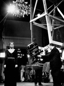 Hitchcock preps for a scene with Ingrid Bergman in his 1946 film Notorious