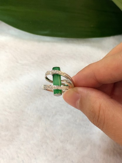 green cylindrical jade ring
