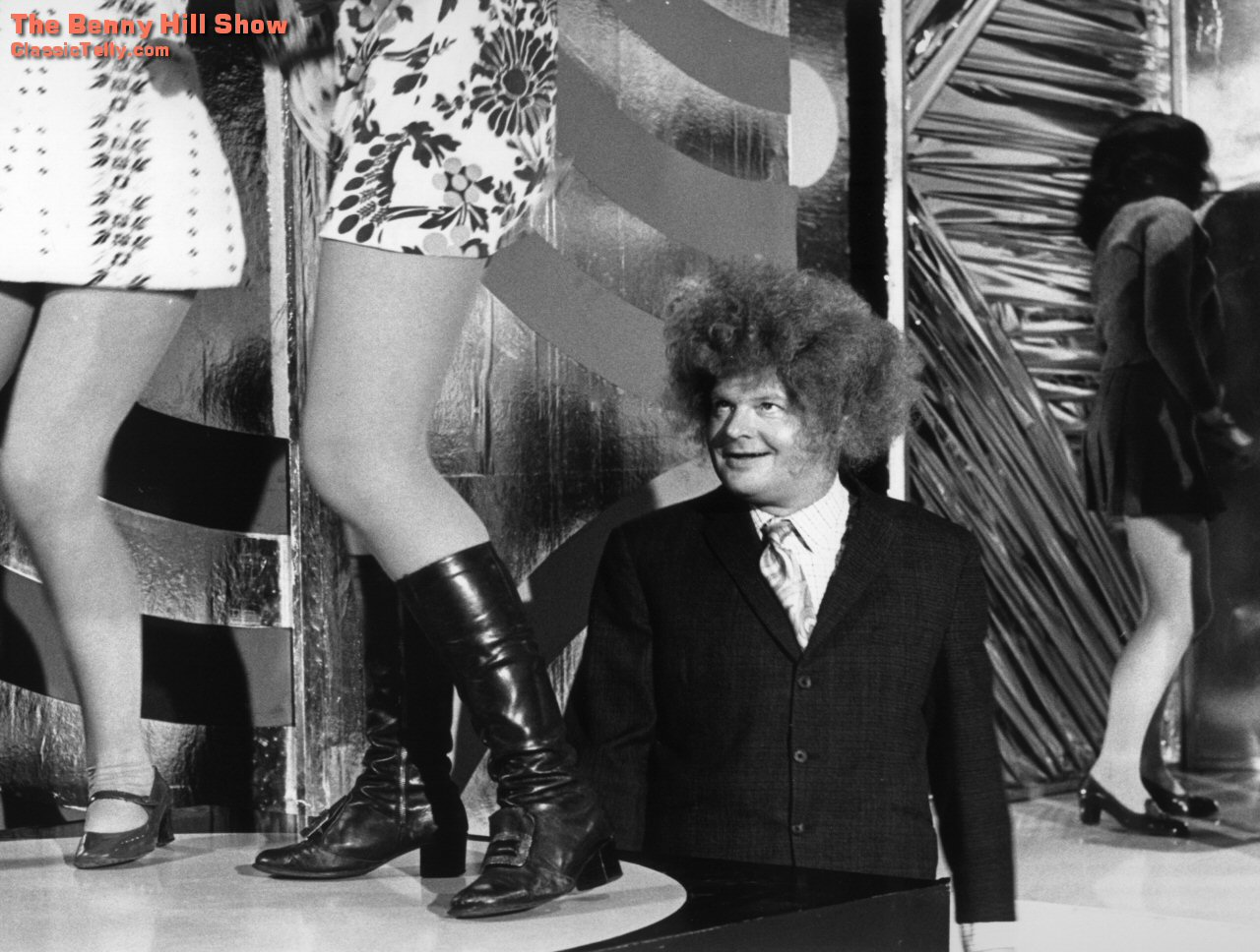 Benny Hill in a wig