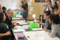 Superintendent Torlakson and students Taylor Piatt (seated next to Torlakson), Andrew Harrison, and Issayra Villalba work to develop their model to explain the seasons.