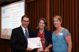 State Deputy Superintendent Tom Adams and CSTA President Lisa Hegdahl present the PAEMST California State Finalist Award to Julie McGough.