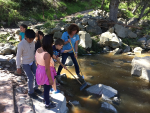 Elementary students collect macro-invertebrates from a local creek.