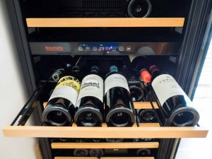A rack of wine in the fridge