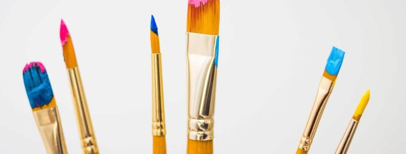 Gerüstplanen und Bauschilder der Bernd Schienmann GmbH im farbenfrohen Design mit professionellen Fotos von Claudia Link Fotografie und Grafikdesign