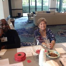 our members John and Diane sitting at the welcome table