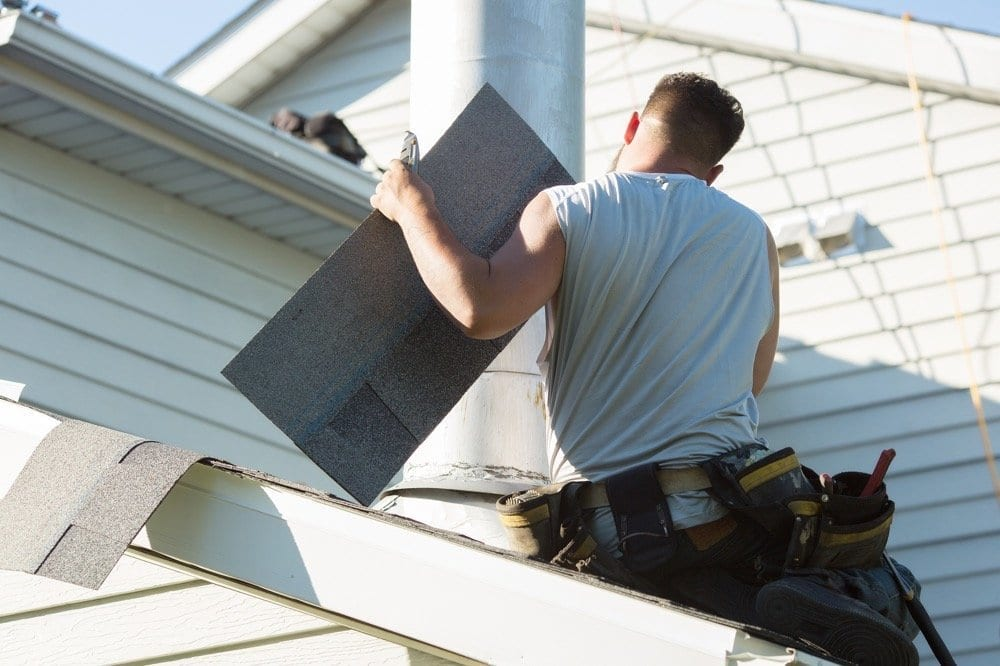 Calgary Roofing Companies | Claw Roofing Specialists Calgary Roofing Company - Claw Roofing - Roofer removing asphalt shingles