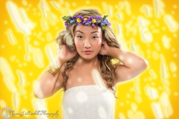 model on photoshopped glowing yellow background