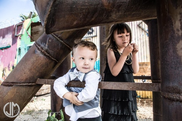 kids wearing formal wear in an industrial setting