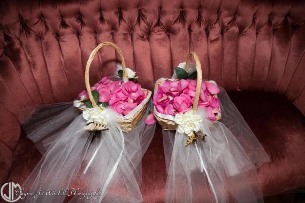 flower girl baskets on a velvet couch